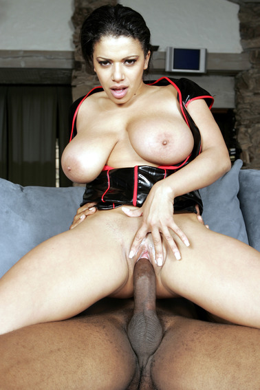 Busty black slut rides a big cock