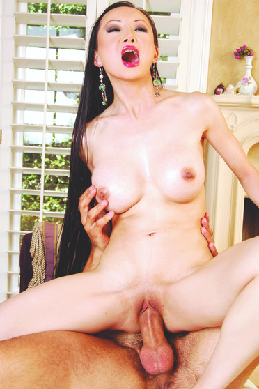 Asian slut rides a big cock